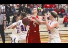 Luverne's Jadyn Anderson draws a foul from H-BC's Abby Knobloch during Tuesday's girls' basketball game in Luverne.