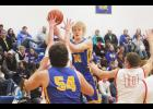 Adrian senior Christian Weidert tossed in 21 points to lead the Dragons to a 67-57 home win over Fulda Friday.
