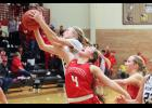 Luverne's Averill Sehr battles for a rebound with a Jackson County Central player during Thursday's tournament game in Worthington.