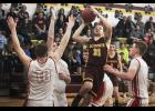 Ellsworth' Sam Kramer puts up a shot in traffic during Thursday's tournament win over Fulda in Ellsworth.