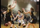 H-BC's Grace Bundesen delivers a bounce pass that leads to one of her seven assists during Friday's South Section 3A championship game in Marshall.