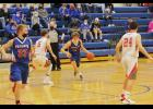Ty Bundesen drives to the basket during H-BC's regular season finale against W-WG Saturday in Hills. The Patriots had their five-game winning streak snapped by the Chargers as W-WG defeated H-BC 72-53.