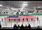 Members of the Blue Mound Figure Skaters stretch Old Glory across the ice as a part of their Salute to the Troops number during Friday's Ice Show at the Blue Mound Ice Arena.