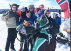 Steve Bakken, a 2000 Hills-Beaver Creek High School graduate, takes a break during the Birkebeiner Ski Race in Norway March 16 to pose for a picture with some members of a micro party celebrating the event. The stuffed moose in the photo belongs to his six-year old son, Will. Steve and his wife, Mary, purchased the moose during a visit to Norway shortly before Will was born.