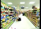 Sunshine store manager Jason Oye stocks shelves in Luverne on March 26.