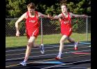 Luverne senior Jeremiah Dooyema takes the baton from his brother, Jed Dooyema, during the 800-meter relay at the Luverne Quadrangular Tuesday.