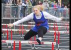 Hills-Beaver Creek sophomore Abby Knobloch clears an obstacle during the 100-meter hurdles at the Cardinal Relays in Luverne April 9. Knobloch placed seventh in the 300-meter hurdles.