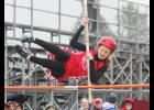 Luverne's Elise Jarchow prepares to clear the bar during the pole vault competition at the Cardinal Relays in Luverne April 9. Jarchow placed second in the event to help the LHS girls win the team title.