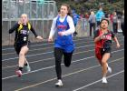 H-BC junior Sidney Ficks sprints down the track during the 100-meter dash at the Cardinal Relays in Luverne Thursday.