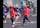 Hailey Kruse grabs the baton from Meghann Mollberg during the 800-meter relay at the Cardinal Relays in Luverne Thursday.