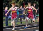 Ellsworth's Kade Boltjes prepares to receive the baton from Sam Kramer during the 400-meter relay at the Cardinal Relays in Luverne Tuesday.