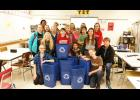 The student council at Luverne Middle School challenged their peers to recycle more paper at school and this fall organized the purchase and distribution of 68 blue plastic recycling containers for classroom use. The group also organized and funded 17 education supply kits for students in Haiti. Pictured with the recycling bins are (front, leaning or kneeling from left) Lauren Ver Steeg, Regan Feit, Mia Wenzel, Gryphon Noerenberg, Jordan Winter, (middle standing) Sophia Lanoue, Elise Jarchow, Ainslie Robins