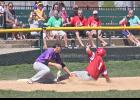 Luverne's Luke Nibbelink is tagged out by Pipestone's third baseman as the Redbird runner tried to an extra base during Sunday's amateur baseball opener at Redbird Field.