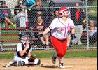 Luverne's Rylee Olson follows the flight of the ball after cracking a double during Thursday's home doubleheader against Pipestone.