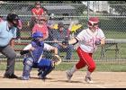 Luverne's Rylee Olson leaves the batter's box after making contact at the plate during Monday's 15-0 home win over Adrian Area.