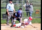 Rozilyn Oye slides across home plate to score a run during Wednesday's home doubleheader sweep of Windom.