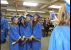 Classmate Miah Kunkel (right) snaps a memory shot of (from left) Megan Fuerstenberg, Brisa Zebe, Madison Leopold and Emma Fuerstenberg in the media center prior to the graduation ceremonies Friday night, May 24.
