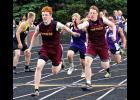 Kade Boltjes prepares to receive the baton from Cole Boltjes during the 400-meter relay Thursday in Luverne.