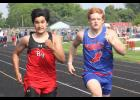 H-BC's Gavin Wysong pushes a Redwood Valley runner during the 100-meter dash at the section meet in Luverne Thursday.