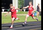Jed Dooyema reaches for the baton from Matt Hup during the 800-meter relay at the section meet in Pipestone Thursday.