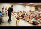 "Mr. Twister (aka Bob Anderson of Sioux Falls, South Dakota) kicks off the Rock County Library summer reading events Tuesday afternoon, June 4, with a balloon show attended by 235 children and adults. Mr. Twister used his balloon creations to tell the story of ""Captain Spaceship and the Giant Mutant Space Worms,"" among other stories involving twisting balloons into various shapes."