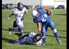 Tri-State Buffalo Cody Scholten is tripped up by a Southwest Minnesota defender during Saturday's football game in Hills.