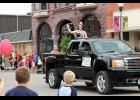 Rock County Dairy Princess Calissa Lubben waves to crowds during the Buffalo Days parade in Luverne earlier this month when she handed out cheese sticks.