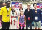 Five members of the Luverne Tae Kwon Do Club tested their skills at the USA Tae Kwon Do National Championships in Minneapolis June 28-July 4. The local competitors include (front) Brynlee Lass, (back, from left) Luci Bommersbach (second), Cody Henrichs, Perceyis Trierweiler and Jack Bommersbach. Pictured with the competitors is coach Jordan Relford (far left).