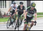 South Dakota riders (from right to left)) Ryan Waterfall (Milbank), Jens Kuiper (Watertown) and Jade Miller (Milbank) make the turn into the Beaver Creek donut stop during the Tour de Donut Minnesota Saturday.