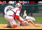 Luverne catcher Colby Crabtree slaps a tag on a sliding Tracy runner during Saturday's Sub-District Tournament game in Luverne.