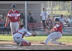 Luverne's Phillip Paquette slides home with one of 24 runs during Wednesday's rout of Tracy.
