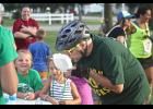 Tim Gust, a member of the Quack Attack squad that won the team title at the Sixth World Wienerman Championships in Luverne Thursday, consumes a hot dog salad prior to completing the biking portion of the race.