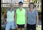 Melissa Sandbulte (middle) fired a five-over-par 77 to repeat as champion of the LCC's Women's Club Tournament Saturday. Mary Jo Graphenteen (left) and Paula Lammert (right) placed second and third.
