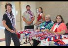 Pictured Thursday, Aug. 20, at the high school open house are (from left) Donna Burgers, Zach Wagenaar, Alli LaRock, Marilyn Nelson and Glenda Kuehl selling Spirit Scarves.