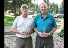 Two first-time champions were honored at the end of Saturday's Seniors' Club Tournament at the LCC. Joe Dorhout (left) won the gross title and Roger Tollefson (right) claimed the net crown.