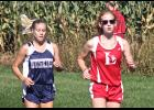 Luverne's Claire Baustian (right) helped the Cardinal girls place second as a team during the Bruce Gluf Classic Saturday in Luverne.