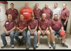 The custodians at Luverne Public Schools are this year's parade marshals for Saturday's 65th annual Tri-State Band Festival. Pictured in front from left are David Eberlein, Todd Mann, Randy DeSplinter, Dwight Smedsrud, Ron Stuckenbroker, (back row) Rod Rosin, Wes Jansen, Jason Brecher, Scott Edwards, Brian Pick and Randy Walgrave.