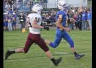 Adrian senior quarterback Ryan Wieneke scores on a five-yard touchdown run in the first quarter of Friday's home loss to New Ulm Cathedral.