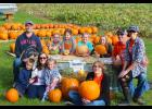 Jennica's Journey Pumpkin Patch event Saturday drew about 125 people to Bert Verhey's produce garden along River Road near the city park. Family and friends supporting the effort Saturday included (front, from left) Ian Iveland, Jocelyn Iveland, Nora Iveland, Jase Arp, (back) Luke Iveland, Jennica Arp, Jolie Arp, Carley Domino, Jaelyn Arp and Jennica's parents, Jerad and Jill Arp.