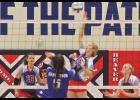Whitney Elbers drills one of her nine kills during Monday's 3-2 home win over Garretson.