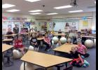 "Luverne Elementary School students in Brooke Van Essen's third-grade classroom demonstrate their new flexible seating options that they received courtesy of a Monsanto grant through ""America's Farmers Grow Communities."""