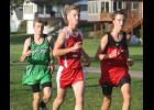 Luverne's Camden Janiszeski (left) helped the Cardinal boys place fifth as a team at the Adrian Invitational Oct. 8.