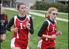 Luverne's Gabrielle Ferrell (left) and Claire Baustian match strides during Tuesday's Adrian Invitational.