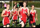 Luverne's Adam Fodness (left), Hunter Hamann (second left), Erik Wohnoutka (second, right) and Austin Winter (right) run together as a pack during the Adrian Invitational Oct. 13. The Cards placed seventh at the event.
