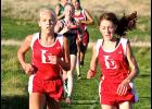 Luverne's Regan Feit (left) and Tenley Nelson (right) placed second and third respectively in the Small School Division of the Big South Conference Cross Country Championships Tuesday in Worthington.