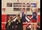 H-BC's Kourtney Rozeboom and Sidney Fick challenge a SWC spiker at the net during Friday's tournament match in Hills.