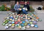 United Methodist Church Pastor Dorie Hall (left) and artist Cindy Reverts display some of the handmade, hand-painted bowls that will be used for the church soup supper Friday night. There are more than 100 in all that will be sold to support the church and the arts.