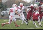 Luverne sophomore Jake Haugen makes a cut to avoid Fairmont defenders during Saturday's game in Fairmont.
