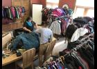 SHARE volunteers Destiny Ripka and James Chanthalangsy sort through hundreds of donated coats Friday afternoon in the Rock County Atlas office in the Cragoe building in downtown Luverne ahead of Saturday's distribution. Another distribution is planned for Thursday evening.