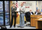 Barb Berghorst (left) receives a certificate of achievement from Luverne Mayor Pat Baustian.